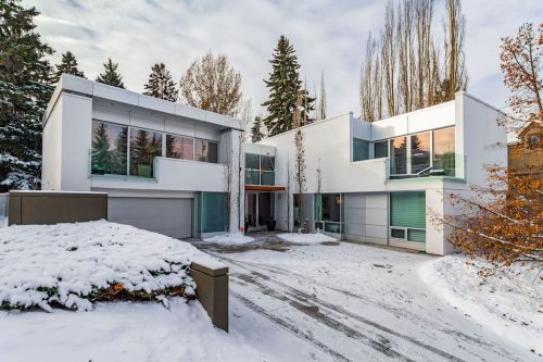 Winter luxury house photo with modern architecture for sale by Realtor Dennis Plintz.