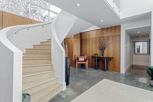Beautiful curved staircase at luxury home for sale 4224 Britannia Drive SW Calgary