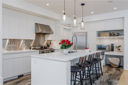 Chefs kitchen at 4224 Britannia Drive with white island and professional appliances.
