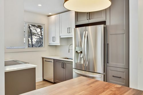 Fully renovated kitchen in bungalow at 1212 60 Street SE with secondary suite in Calgary. For sale by Plintz Real Estate.