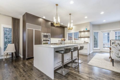 Kitchen island and two-toned cabinetry at 5555 Elbow Drive SW for sale by Plintz Real Estate