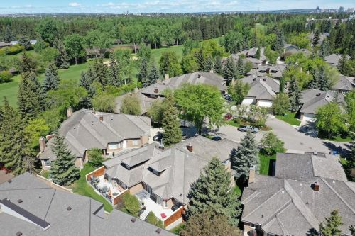 Aerial view of Country Club Estates Luxury Villas overlooking Calgary Golf Course for sale by Plintz Real Estate