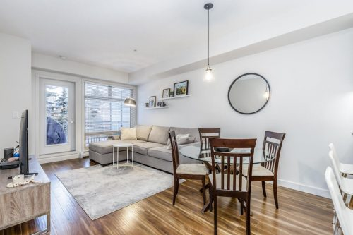 Open concept living and dining room at #216, 323 20 Avenue SW Calgary