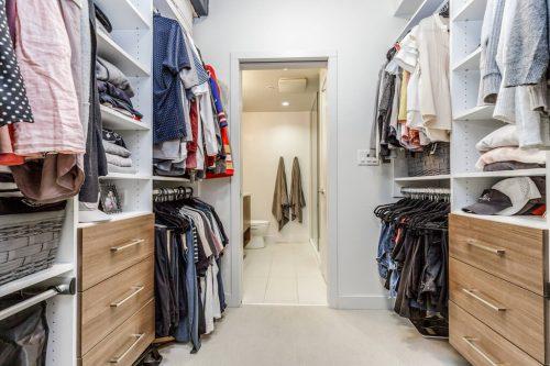 Master bedroom walk through closet to ensuite bath at 216, 323 20 Avenue SW Calgary condo