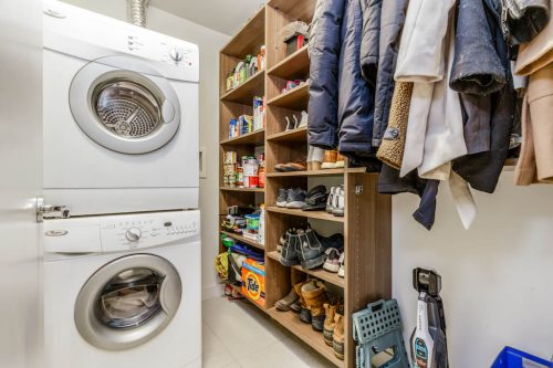 Laundry room with storage in condo for sale by Plintz Real Estate in Calgary
