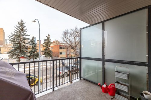 Balcony with partial view of downtown Calgary from unit 216 in the Tribeca Mission condo for sale by Plintz Real Estate