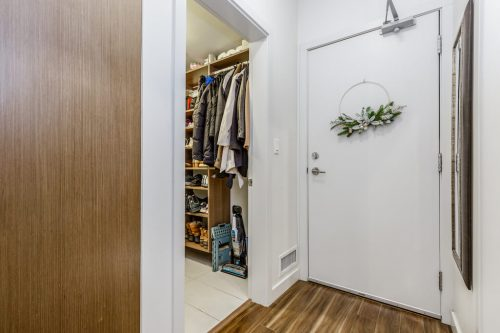 Condo entrance with laundry room and storage