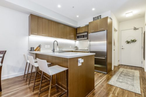 Entrance to open concept condo for sale by Plintz Real Estate in Calgary