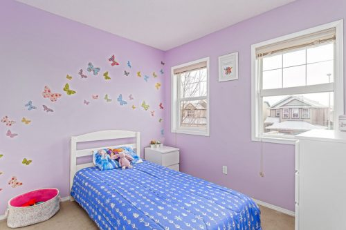 Girls pink butterfly bedroom in Calgary Alberta home for sale by Plintz Real Estate.