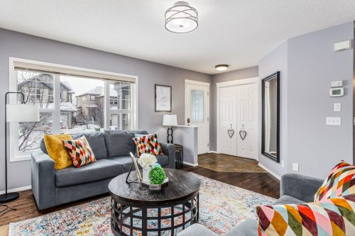 Living room of detached home for sale in Calgary by Plintz Real Estate
