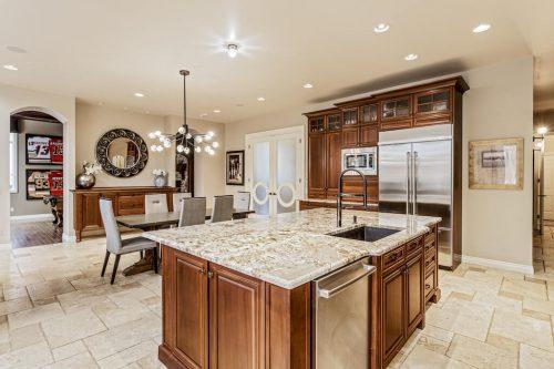 Luxury kitchen island granite 32 Wentwillow Lane SW Calgary for sale Plintz Real Estate