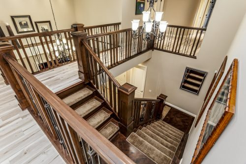 Gorgeous African Hardwood staircase for sale at 32 Wentwillow Lane SW Calgary for sale by Plintz Real Estate