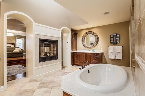 BainUltra soaker tub in luxury ensuite bath at 32 Wentwillow Lane SW West Springs Calgary for sale by Plintz Real Estate Realtor