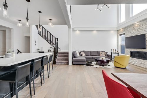 Luxury modern home with two storey great room and black and white finished in Calgary house for sale by Plintz Real Estate