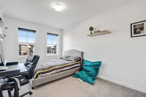 Kids bedroom with 2 windows and a desk in Calgary