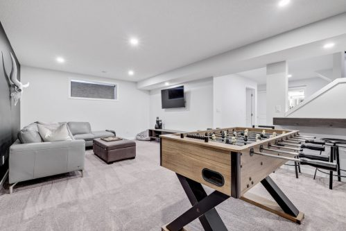 Basement recreation and media room at Evansglen Drive NW home