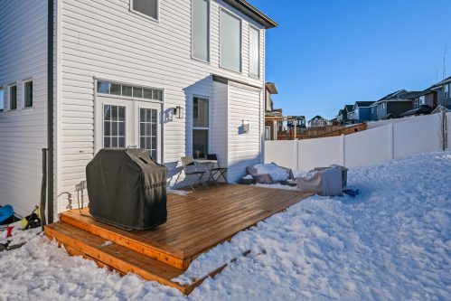 Snowy backyard and deck in Calgary Alberta