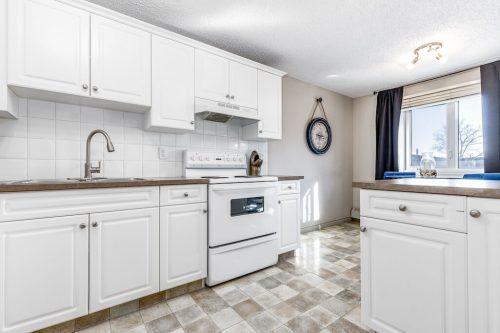 White condo kitchen in Calgary