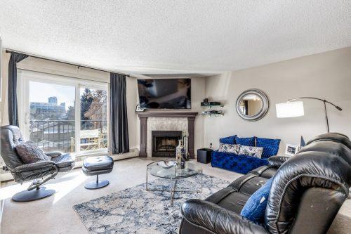 Corner fireplace in Bridgeland Calgary condo for sale by Realtor Dennis Plintz Real Estate