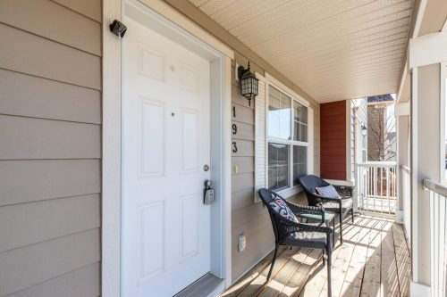 Sunny front veranda of Chestermere townhouse for sale by Plintz Real Estate