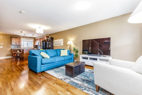 Blue sofa at 193 Rainbow Falls Manor townhome for sale by Plintz Real Estate