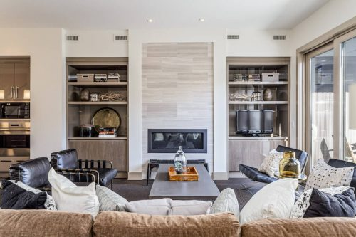 Beautiful floor-to-ceiling tile fireplace at 4 Valour Circle SW