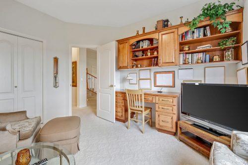 Basement office bedroom at 140 Sierra Morena Landing SW Calgary for sale by Plintz Real Estate