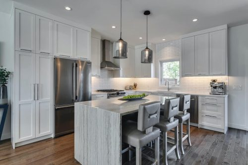 White kitchen with island at 18 Mayfair Road SW Calgary for sale by Plintz Real Estate