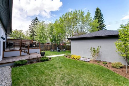 Large private backyard with double garage at 18 Mayfair Road SW in Calgary for sale by Realtor Dennis Plintz