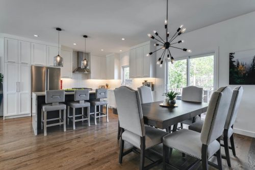 Dining room with sputnik chandelier in renovated bungalow for sale by Plintz Real Estate
