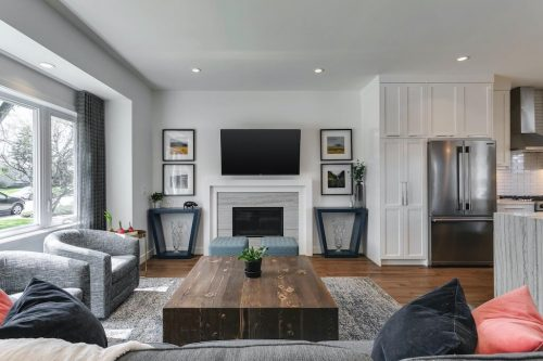 Fireplace in living room of fully renovated bungalow at 18 Mayfair Road SW Calgary home for sale by Plintz Real Estate