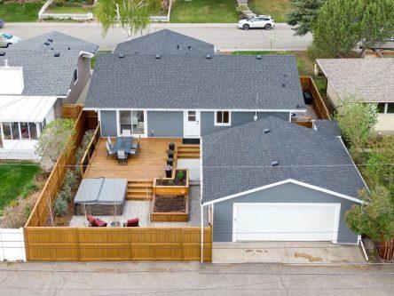 Backyard aerial of 460 Lake Topax Cres Bonavista Calgary