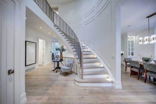 Elegant curved staircase in luxury home for sale by Plintz Real Estate.