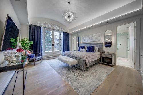 Master bedroom with barrel ceilings and private balcony in luxury home for sale by Plintz Real Estate at 907 Edinburgh Road SW Calgary