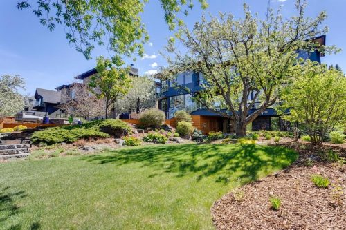 Mature trees and lush landscaping in backyard of 120 Wildwood Drive SW