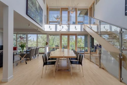 Gorgeous 2 story dining room with floor-to-ceiling windows