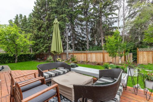 Deck in large yard in Lakeview Village home in Calgary