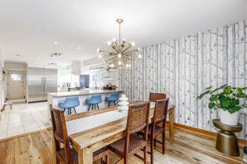 Mid century interior design dining room at 6911 Lowes Court SW Home for sale in Calgary