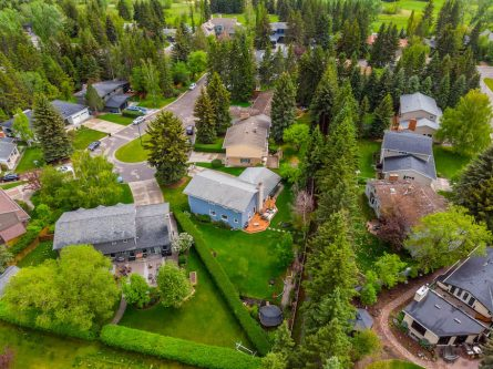 Aerial photo of large pie shaped lot luxury home in Lakeview Village Calgary