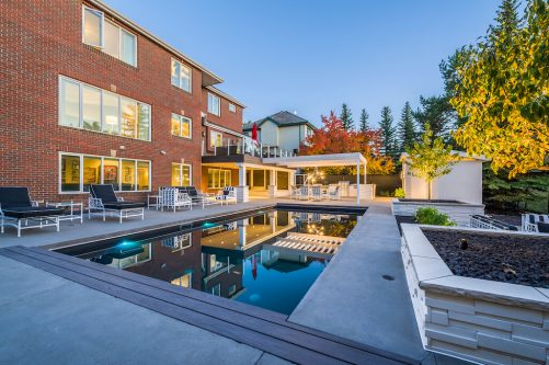 Luxury pool and backyard at 151 Pumpmeadow Place SW in Calgary for sale by Plintz Real Estate