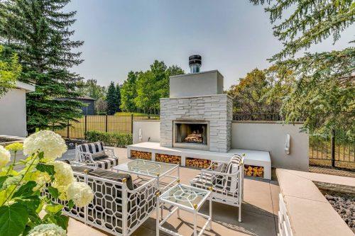 Luxury outdoor fireplace at 151 Pumpmeadow Place SW in Calgary Alberta